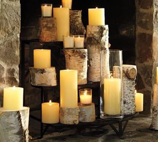 świece na brzozie w sztucznym kominku